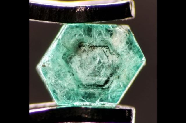 Hexagonal pattern and concentraction of black inclusions in rough Emerald from Swat, Pakistan. Photo by Fahad Abbas Sheikh