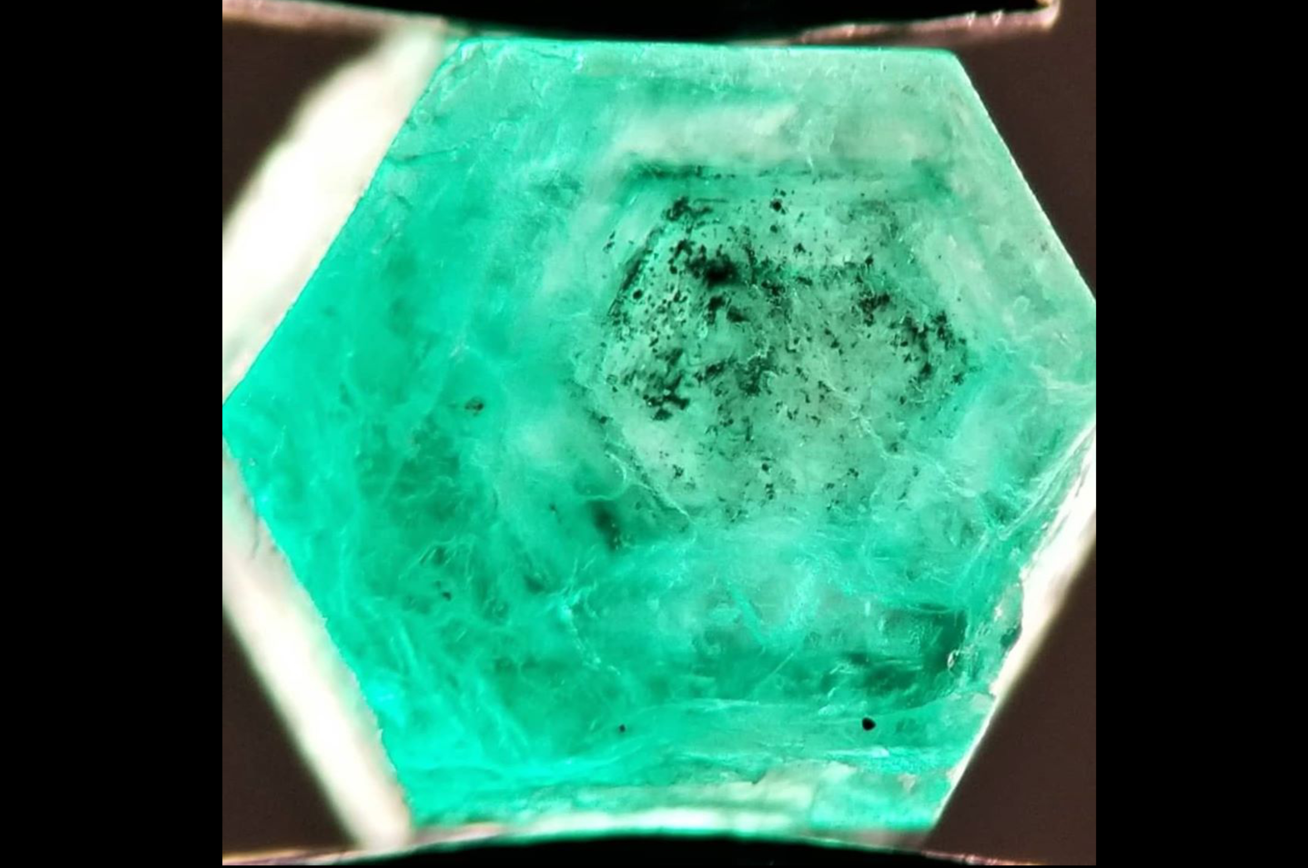 Probably Biotite inclusions in rough Emerald from Swat. Photo by Fahad Abbas Sheikh