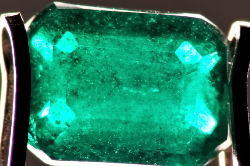 Emerald from Swat peppered with minute and colorless mineral inclusions along with countless tiny flakes, which appear to be mica. Photo by Fahad Abbas Sheikh