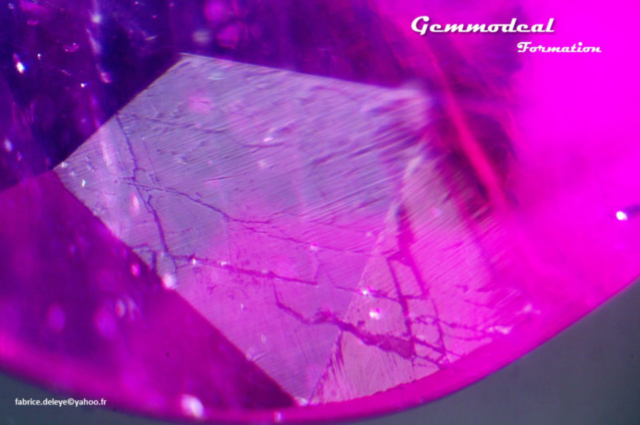 Surface of a lead glass filled ruby with healed fractures reaching the surface of the gemstone. Photo by Fabrice Deleye