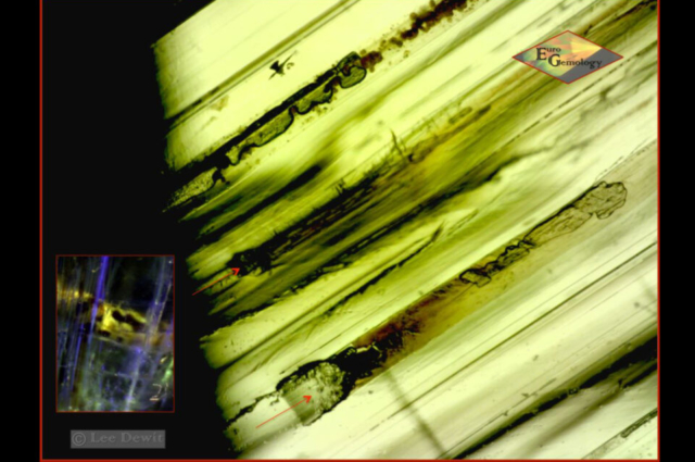 Several parallel growth tubes with dryed residue, some of them reaching the surface. Through fluorescence microscopy, it has already been proved in the past, that this gemstone had been treated. Photo by Euro Gemology