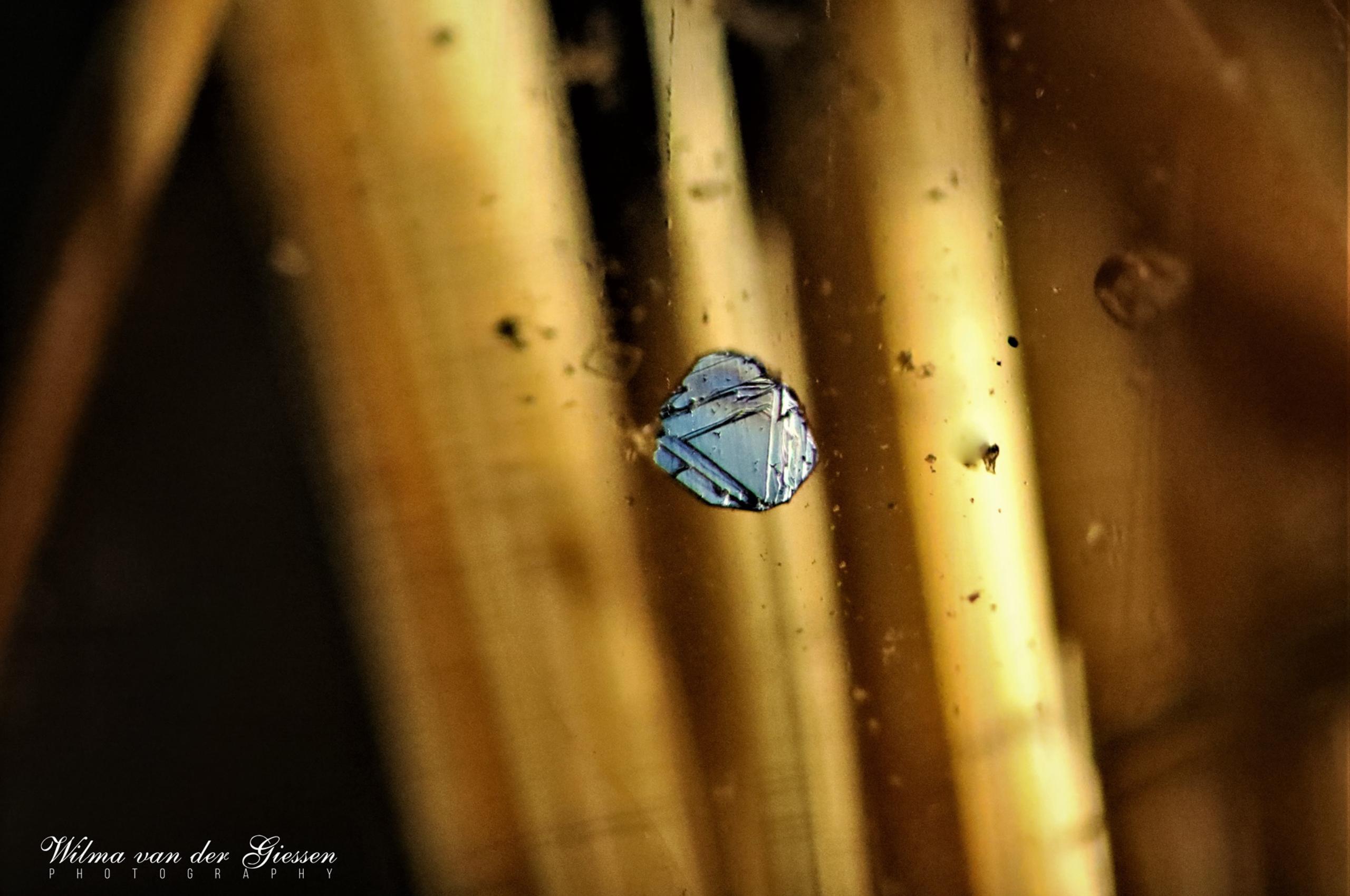 Hematite in Quartz from Brazil. Photo by Wilma Van Der Giessen