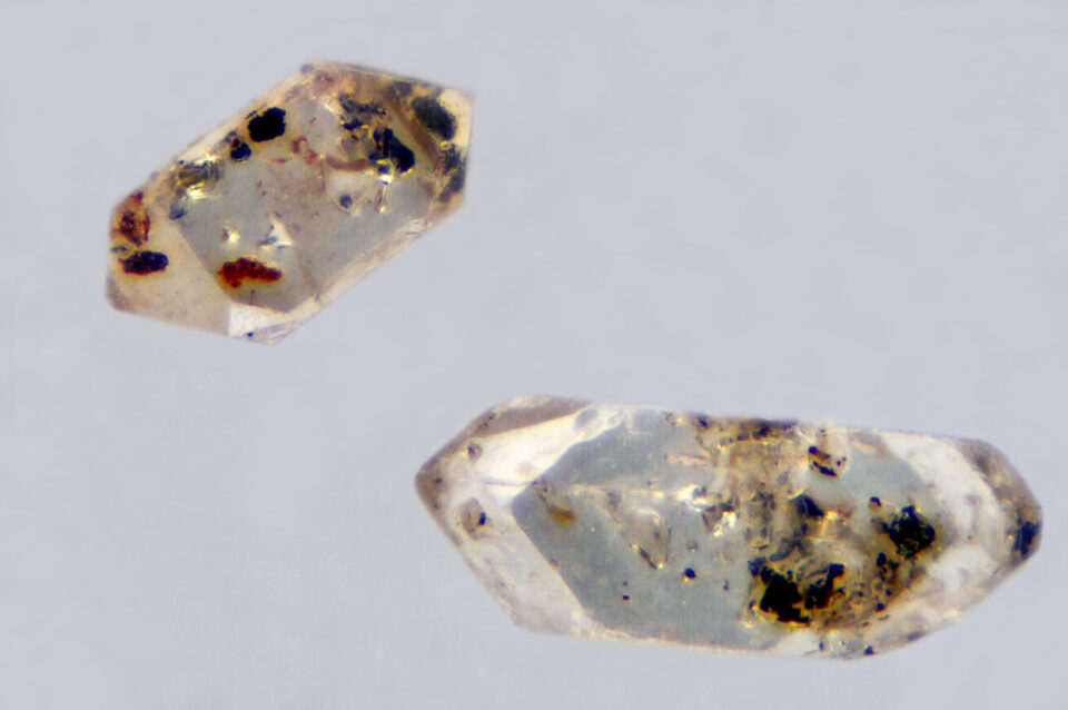 Two zircons with many dark inclusions from Leghorn, Tuscany, Italy. Photo by Marco Bonifazi